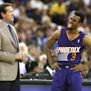 Phoenix Suns head coach Jeff Hornacek watches guard Ish Smith's reaction after a foul call during the first quarter against the Sacramento Kings in an NBA basketball game in Sacramento, Calif., Wednesday, April 16, 2014. The Suns won 104-99 The Associate