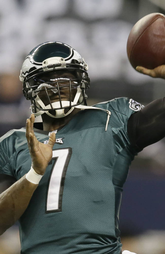 Philadelphia Eagles quarterback Michael Vick (7) tosses a football before an NFL football game against the Dallas Cowboys Sunday, Dec. 29, 2013, in Arlington, Texas
