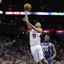 San Antonio Spurs' Tony Parker (9), of France, shoots over a falling Dallas Mavericks' Monta Ellis, left, as Mavericks' DeJuan Blair (45) looks on during the first half of Game 2 of the opening-round NBA basketball playoff series, Wednesday, April 23, 201