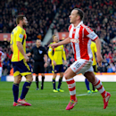 Stoke City s Charlie Adam celebrates scoring his side s first goal of the game during the English Premier League soccer match between Stoke City and Sunderland at the Britannia Stadium, Stoke On Trent, England, Saturday, Nov. 23. 2013