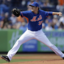 New York Mets starting pitcher John Lannan throws during the first inning of an exhibition spring training baseball game against the Miami Marlins Saturday, March 1, 2014, in Port St. Lucie, Fla The Associated Press