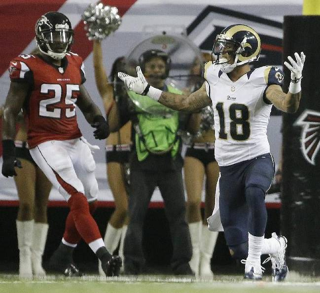 St. Louis Rams wide receiver Austin Pettis (18) raises his hands to the officials after being fouled while trying to catch a ball against the Atlanta Falcons during the second half of an NFL football game, Sunday, Sept. 15, 2013, in Atlanta