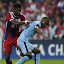 Bayern's David Alaba, left, and Manchester City's Fernando challenge for the ball during the Champions League Group E soccer match between FC Bayern Munich and Manchester City at Allianz Arena in Munich, southern Germany, Wednesday Sept. 17, 2014
