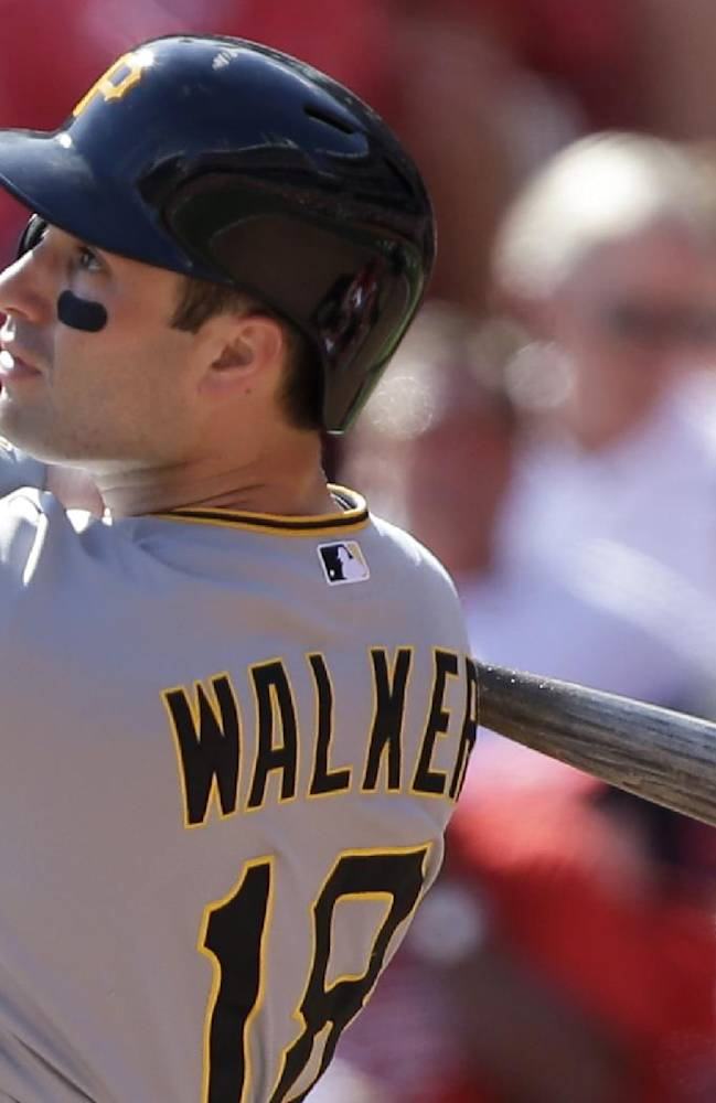 Pittsburgh Pirates' Neil Walker hits a solo home run off Cincinnati Reds starting pitcher Bronson Arroyo in the fifth inning of a baseball game, Saturday, Sept. 28, 2013, in Cincinnati. It was the second home run of the game for Walker