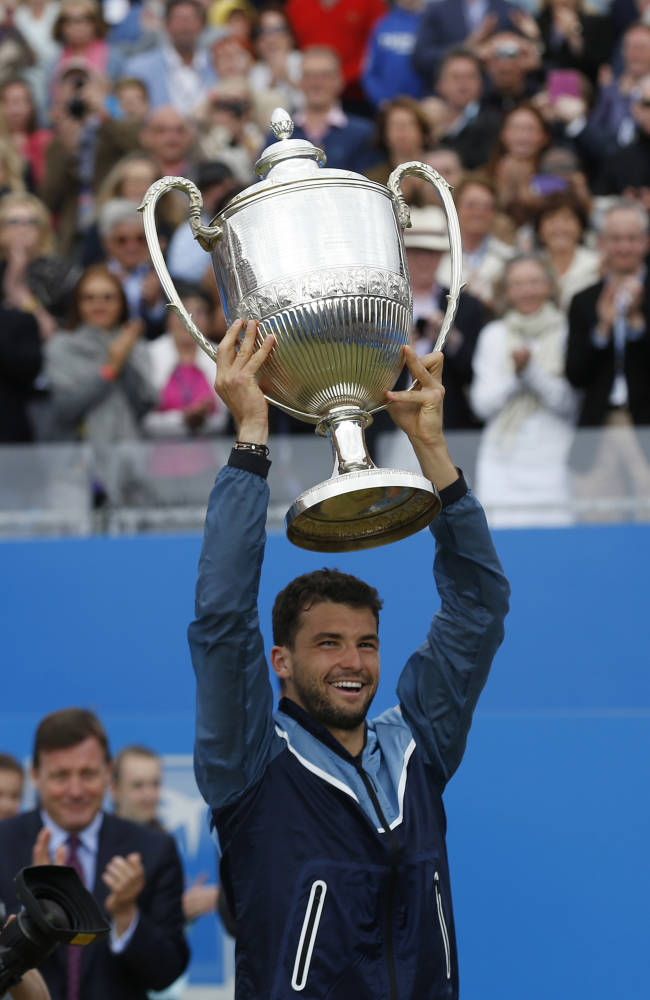 Dimitrov saves match point to win Queen's final