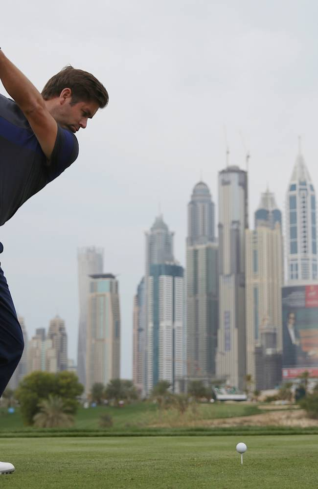 Robert Rock of England tees off on the 8th hole during the final round of the Dubai Desert Classic golf tournament in Dubai, United Arab Emirates, Sunday Feb. 2, 2014