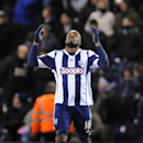 West Brom's Victor Anichebe celebrates after scoring the equalizer against Chelsea during the English Premier League soccer match between West Bromwich Albion and Chelsea at The Hawthorns Stadium in West Bromwich, England, Tuesday, Feb. 11, 2014