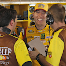 NASCAR driver Kyle Busch shares a laugh with his crew during practice for Sunday's NASCAR Sprint Cup Series auto race at Martinsville Speedway in Martinsville, Va., Friday, Oct. 24, 2014. (AP Photo/Steve Helber)