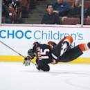 The Ducks' Ryan Getzlaf is up-ended by Calgary's Mark Giordano during the second period at Honda Center Wednesday night Jan. 21, 2015 The Associated Press