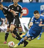 Montreal Impact's Jack McInerney, right, and D.C. United's Luis Silva battle for the ball during first half of a soccer game, Wednesday, June 11, 2014 in Montreal. (AP Photo/The Canadian Press, Graham Hughes)