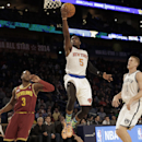 CORRECTS TO TIM HARDAWAY JR., INSTEAD OF VICTOR OLADIPO - Team Webber's Tim Hardaway Jr. (5) of the New York Knicks heads to the basket against Team Hill's Dion Waiters of the Cleveland Cavaliers, left, as Team Webber's Mason Plumlee of the Brooklyn Nets