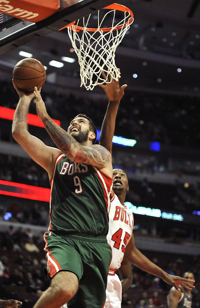 Milwaukee Bucks' Miroslav Raduljica (9), of Serbia, goes up for a shot against Chicago Bulls' Dexter Pittman (45), during the second half of an NBA preseason basketball game in Chicago, Monday, Oct. 21, 2013. Chicago won 105-84