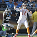 Tampa Bay Buccaneers' Josh McCown (12) throws a pass under pressure from Carolina Panthers' Charles Johnson (95) in the second half of an NFL football game in Charlotte, N.C., Sunday, Dec. 14, 2014 The Associated Press