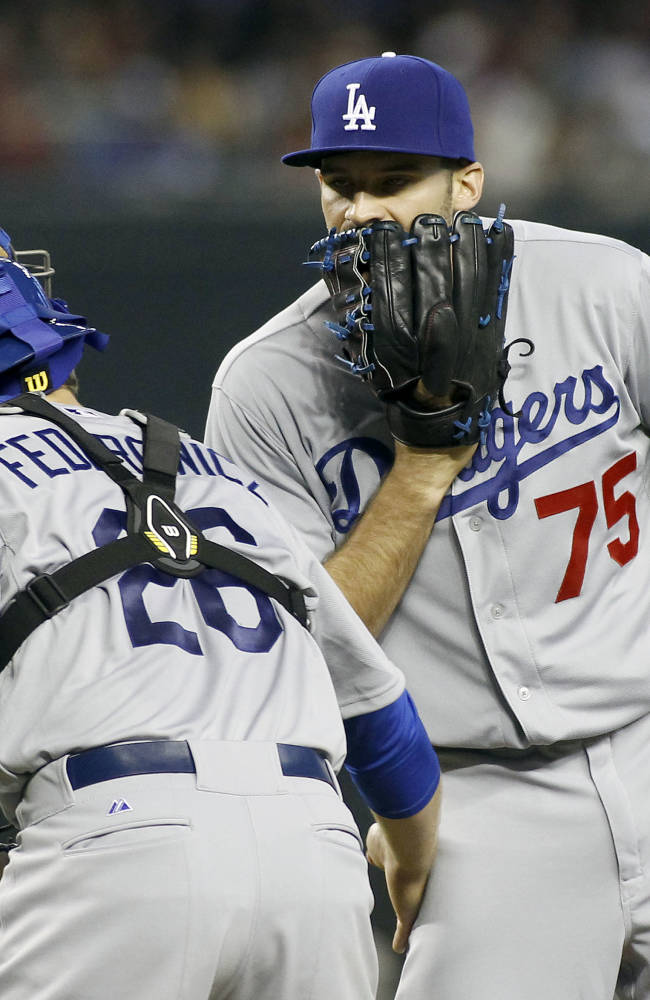 Los Angeles Dodgers' Paco Rodriguez (75) and Tim Federowicz (26) have a discussion on the mound during a timeout against the Arizona Diamondbacks during the sixth inning of a baseball game on Sunday, April 13, 2014, in Phoenix