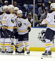Buffalo Sabres' Tyler Myers (57) joins teammates Thomas Vanek (26), Christian Ehrhoff (10) and Tyler Ennis (63) to celebrate Vanek's goal against the New York Islanders in the second period of an NHL hockey game on Tuesday, Oct. 15, 2013, in Uniondale, N.Y. (AP Photo/Kathy Kmonicek)
