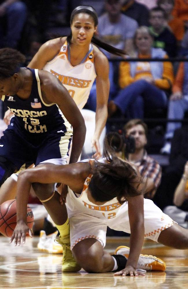 Tennessee forward Bashaara Graves (12) battles for the ball with Georgia Tech guard Tyaunna Marshall (15) in the first half of an NCAA college basketball game on Sunday, Nov. 17, 2013, in Knoxville, Tenn