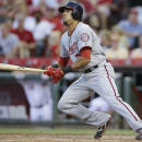 Washington Nationals' Ian Desmond hits a single off Cincinnati Reds starting pitcher Anthony DeSclafani to drive home Michael Taylor in the fifth inning of a baseball game, Friday, May 29, 2015, in Cincinnati. (AP Photo/John Minchillo)