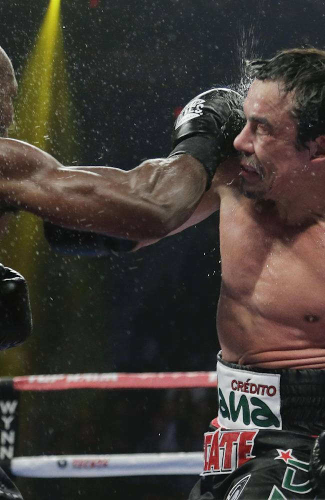 Timothy Bradley, left, exchanges punches with Juan Manuel Marquez in the sixth round during a WBO welterweight title fight, Saturday, Oct. 12, 2013, in Las Vegas. Bradley won by split decision
