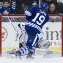 Toronto Maple Leafs forward Joffrey Lupul (19) scores past Los Angeles Kings goalie Jonathan Quick during a shootout in NHL hockey game action in Toronto, Sunday, Dec. 14, 2014 The Associated Press