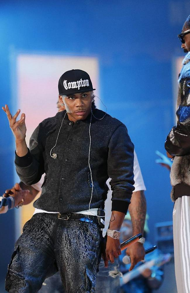 Rapper's Pharrell Williams, Nelly and Snoop Dog, from left, rehearse before the NBA All Star basketball game, Sunday, Feb. 16, 2014, in New Orleans