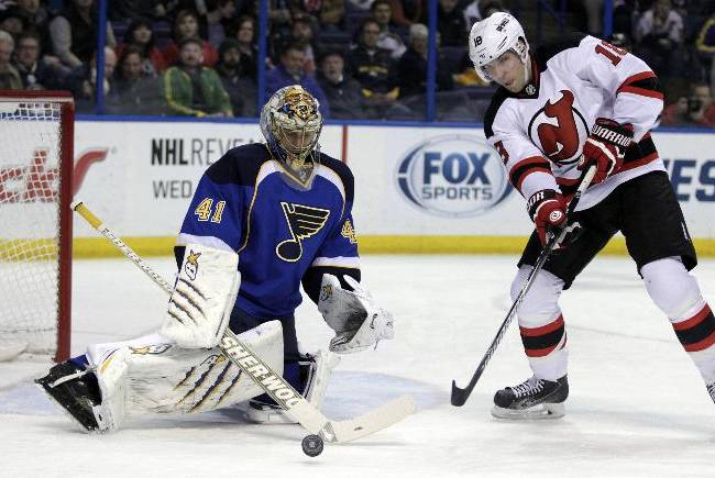 St. Louis Blues goalie Jaroslav Halak (41) makes a stick save on a  point blank shot from New Jersey Devils' Steve Bernier (18) in the first period of an NHL hockey game, Tuesday, Jan. 28, 2014 in St. Louis