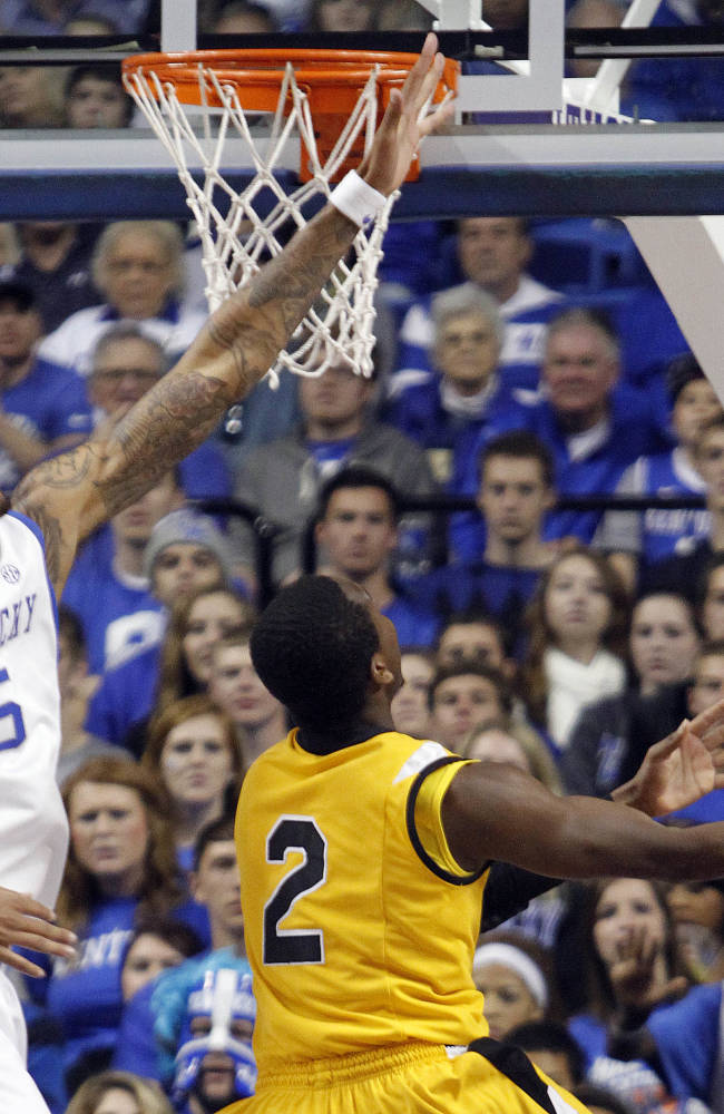 Kentucky's Willie Cauley-Stein (15) pressures the shot of Northern Kentucky's Jordan Jackson (2) during the first half of an NCAA college basketball game, Sunday, Nov. 10, 2013, in Lexington, Ky