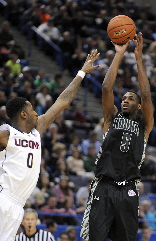 Loyola, Maryland guard Eric Laster (5) shoots over Connecticut forward Phillip Nolan (0) during the first half of an NCAA college basketball game Tuesday, Nov. 26, 201, in Hartford, Conn