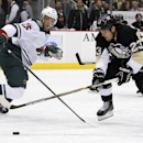 Pittsburgh Penguins' Steve Downie (23) skates past Minnesota Wild's Jonas Brodin (25) but cannot get a shot off in the second period of a NHL preseason hockey game in Pittsburgh, Thursday, Sept. 25, 2014. The Associated Press