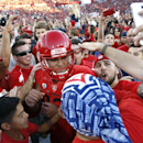 Arizona quarterback Anu Solomon (12) celebrates with fans after defeating Arizona State 42-35 during an NCAA college football game, Friday, Nov. 28, 2014, in Tucson, Ariz. (AP Photo/Rick Scuteri)