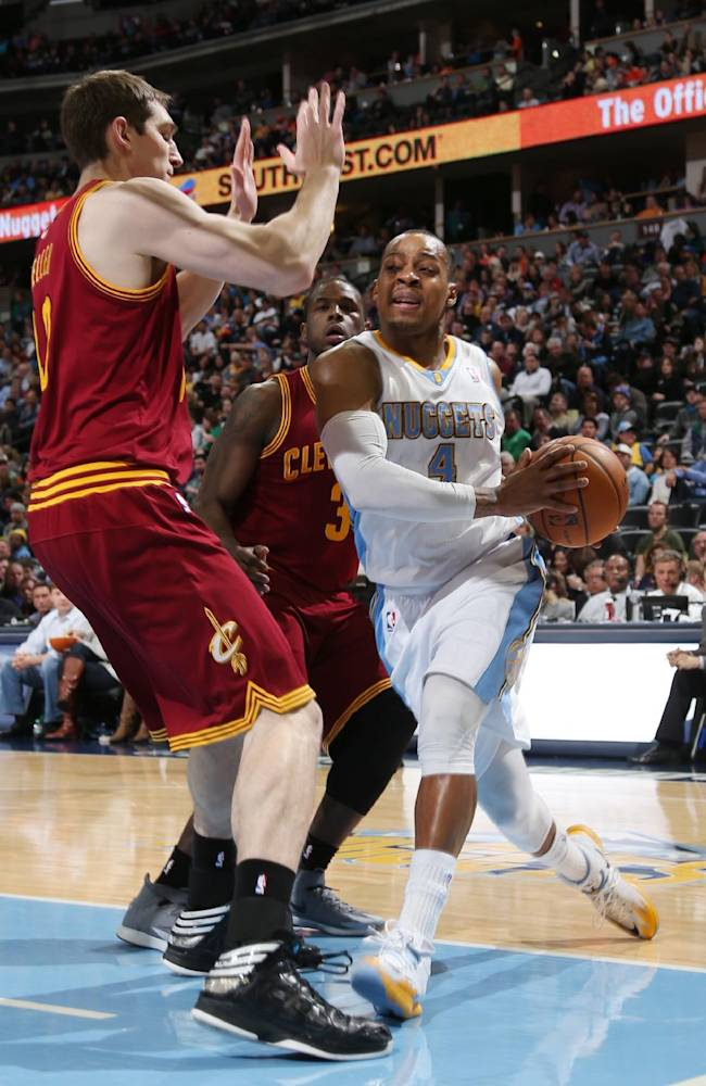 Denver Nuggets guard Randy Foye, front right, drives for shot as Cleveland Cavaliers center Tyler Zeller, front, left, and guard Dion Waiters covers in the third quarter of the Cavaliers' 117-109 victory in an NBA basketball game in Denver on Friday, Jan. 17, 2014