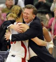 Sacred Heart coach Ed Swanson hugs Callan Taylor after their team's 58-48 victory over Monmouth in the NEC championship final women's basketball game in Fairfield, Conn., Sunday, March 11, 2012. (AP Photo/Fred Beckham)