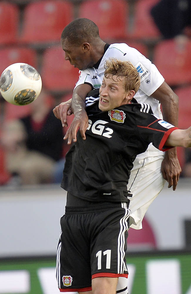Hannover's Marcelo of Brazil, up, and Leverkusen's Stefan Kiessling challenge for the ball during the German first division Bundesliga soccer match between Bayer Leverkusen and Hanover 96 in Leverkusen, Germany, Saturday, Sept. 28, 2013