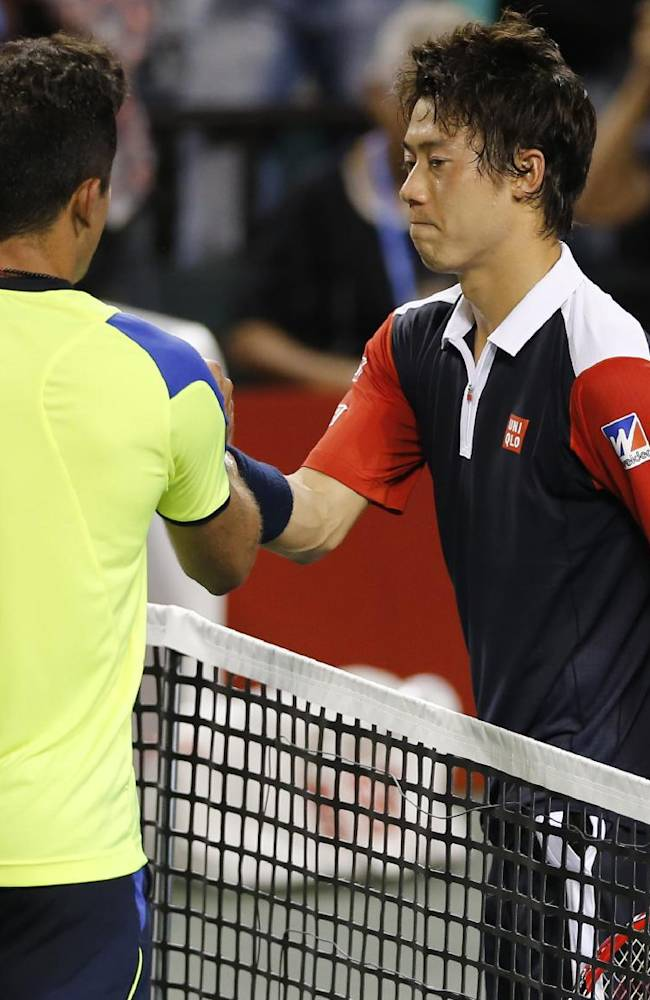 Kei Nishikori of Japan, right, greets Nicolas Almagro of Spain after the quarterfinal of the Japan Open Tennis Championships in Tokyo, Friday, Oct. 4, 2013