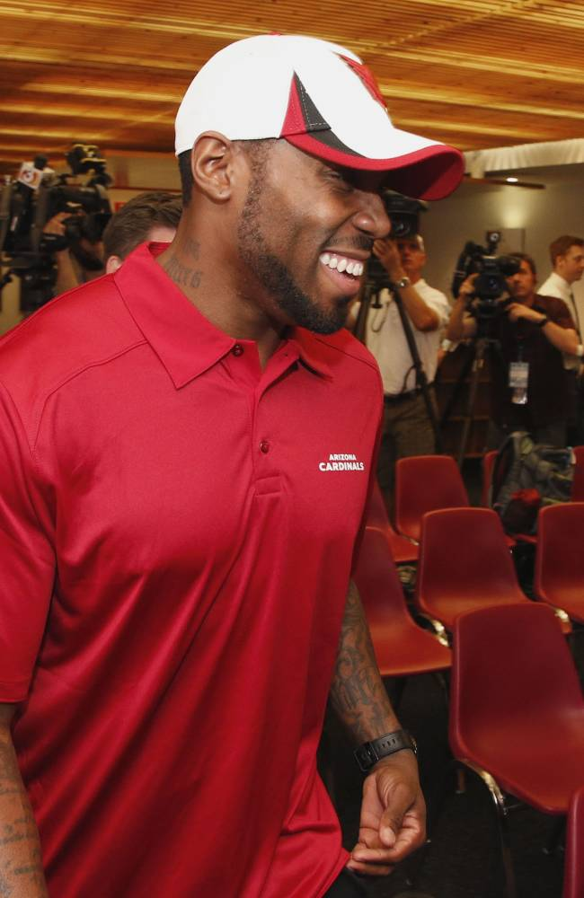 Antonio Cromartie smiles as he arrives for a news conference where the Arizona Cardinals NFL football team introduced its newest player, Thursday, March 20, 2014, in Tempe, Ariz.  Cromartie last played for the New York Jets