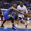 Los Angeles Clippers guard Chris Paul, right, drives past Oklahoma City Thunder guard Russell Westbrook during the first half of an NBA basketball game in Los Angeles, Wednesday, April 9, 2014 The Associated Press