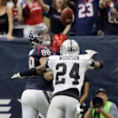 Houston Texans' Garrett Graham catches a 42-yard touchdown pass with Oakland Raiders' Charles Woodson (24) defending during the first half of an NFL football game Sunday, Nov. 17, 2013, in Houston The Associated Press