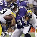 Baltimore Ravens wide receiver Steve Smith (89) can't hang on to a pass as he is hit by Pittsburgh Steelers free safety Mike Mitchell (23) and strong safety Troy Polamalu (43) during the second half of an NFL football game Thursday, Sept. 11, 2014, in Bal