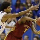Iowa State forward Melvin Ejim (3) passes to a teammate while covered by Kansas forward Kevin Young (40) during the first half of an NCAA college basketball game in Lawrence, Kan., Wednesday, Jan. 9, 2013. (AP Photo/Orlin Wagner)
