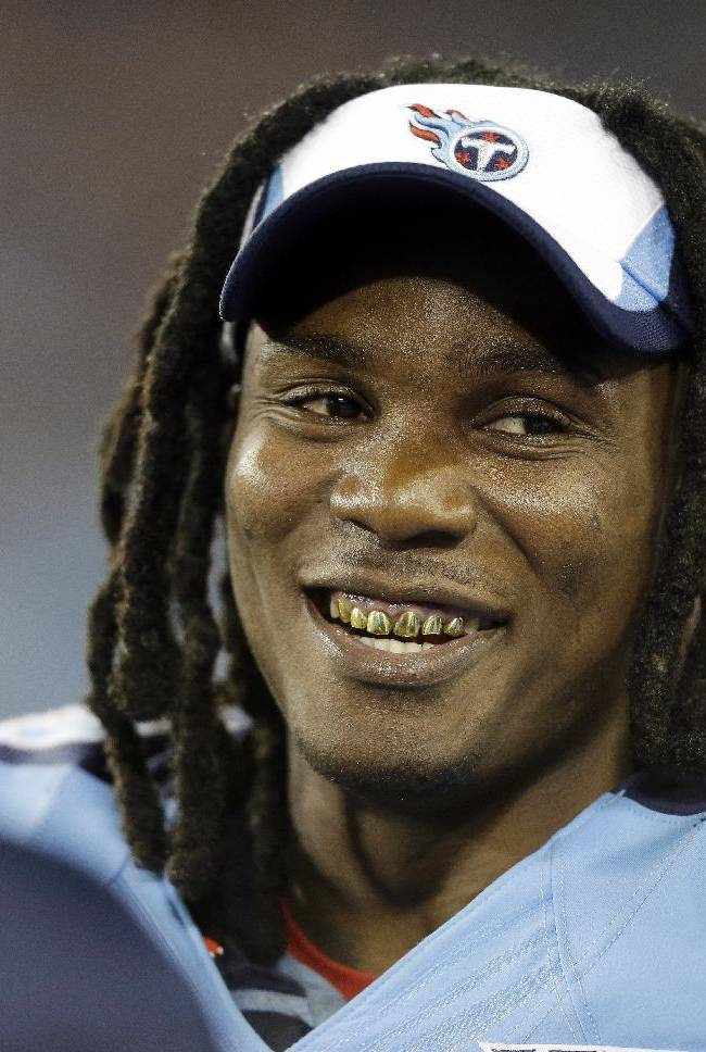 In this Aug. 8, 2013 file photo, Tennessee Titans running back Chris Johnson talks with teammates on the sideline in the third quarter of a preseason NFL football game against the Washington Redskins, in Nashville, Tenn. The Titans have told Chris Johnson they are releasing him after six seasons to avoid paying the $8 million the running back is due in pay in 2014, and the final three seasons left on the $53.5 million contract he signed in September 2011. The Titans announced Johnson has been told he will be released Friday, April 4, 2014