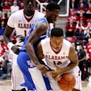 Alabama guard Trevor Releford (12) loses control of the ball while being pressured by Kentucky guard Archie Goodwin (10) during the first half of an NCAA college basketball game at Coleman Coliseum in Tuscaloosa, Ala. on Tuesday, Jan. 22, 2013. (AP Photo/The Tuscaloosa News, Michelle Lepianka Carter)