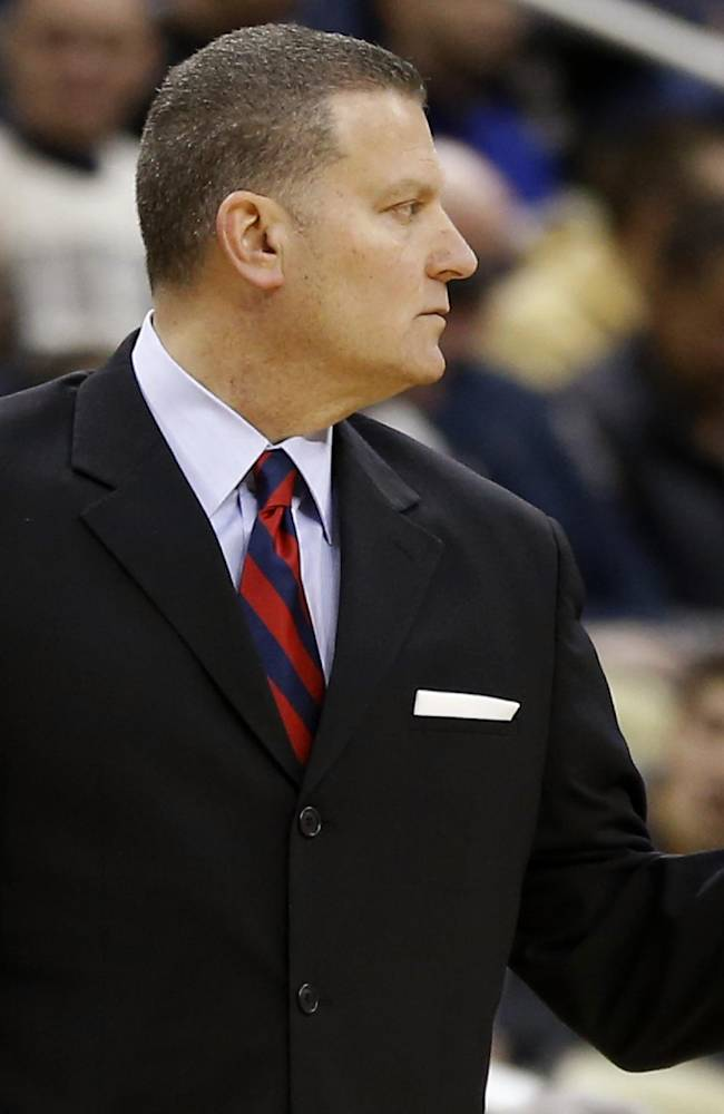 Duquesne head coach Jim Ferry directs his team in the first half of an NCAA college basketball game against Pittsburgh on Saturday, Nov. 30, 2013, in Pittsburgh