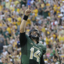 Baylor quarterback Bryce Petty (14) points skyward after completing a touchdown pass pass during the first half of an NCAA college football game against SMU Sunday, Aug. 31, 2014, in Waco, Texas. (AP Photo/LM Otero)