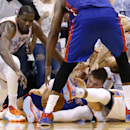 Oklahoma City Thunder forward Kevin Durant (35) reaches into a pileup for a loose ball in the fourth quarter of an NBA basketball game against the Detroit Pistons in Oklahoma City, Wednesday, April 16, 2014. Oklahoma City won 112-111. Pistons forward Jona