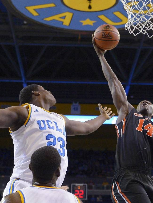 Oregon State forward Daniel Gomis, right, grabs a rebound away from UCLA center Tony Parker during the first half of an NCAA college basketball game, Sunday, March 2, 2014, in Los Angeles