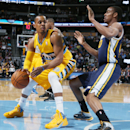 Denver Nuggets guard Randy Foye, left, works ball inside for shot as Utah Jazz guard Alec Burks covers in the first quarter of an NBA basketball game in Denver on Saturday, April 12, 2014 The Associated Press