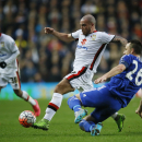 Milton Keynes Dons' Samir Carruthers, left, competes for the ball with Chelsea's captain John Terry during the English FA Cup fourth round soccer match between Milton Keynes Dons and Chelsea at Stadium mk in Milton Keynes, England, Sunday, Jan. 31, 20