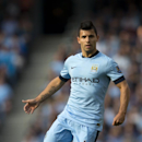Manchester City's Sergio Aguero takes the ball down field during his team's English Premier League soccer match against Chelsea at the Etihad Stadium, Manchester, England, Sunday Sept. 21, 2014