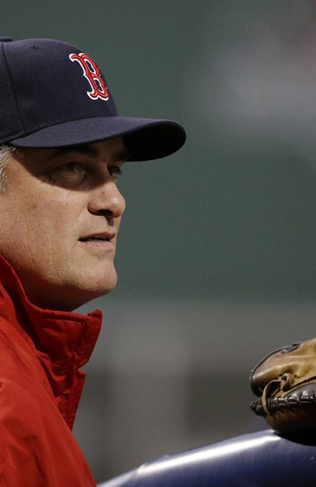 Boston Red Sox manager John Farrell watches batting practice before Game 1 of baseball's World Series against the St. Louis Cardinals Wednesday, Oct. 23, 2013, in Boston
