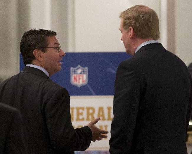 Washington Redskins football team owner Daniel Snyder, left, and NFL Commissioner Roger Goodell, talk during a break in the NFL fall meeting in Washington, Tuesday, Oct. 8, 2013. NFL owners hold their annual fall meeting, with discussions about the upcoming outdoor Super Bowl in New Jersey and player safety initiatives on the agenda