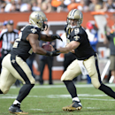 New Orleans Saints quarterback Drew Brees (9) hands off to running back Mark Ingram in the fourth quarter of an NFL football game against the Cleveland Browns Sunday, Sept. 14, 2014, in Cleveland The Associated Press